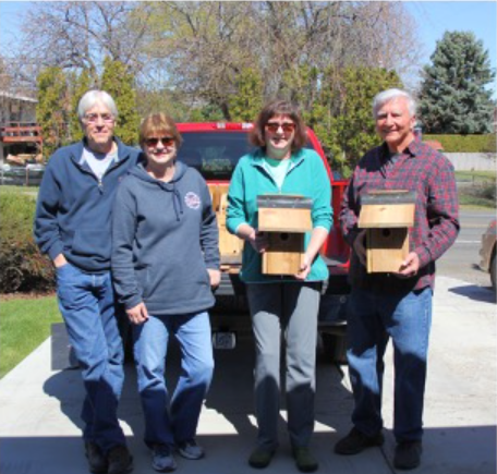 Image - (from left) Mike and Lynne, Karen and Joe showing off the new Bluebird homes